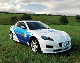 "The Mazda RX-8 Hydrogen RE, developed and commercialized by Mazda, is the world's first practical implementation of a hydrogen rotary engine vehicle. Without compromising the sensations of torque and acceleration nor the exhaust note unique to internal combustion engines, it emits no CO2 and almost no NOx making it the ultimate ""green"" car. In Japan, the vehicle has been offered for lease to local governments and enterprises since 2006, and in 2008 Mazda began to participate in the Norwegian hydrogen highway project ""HyNor."""